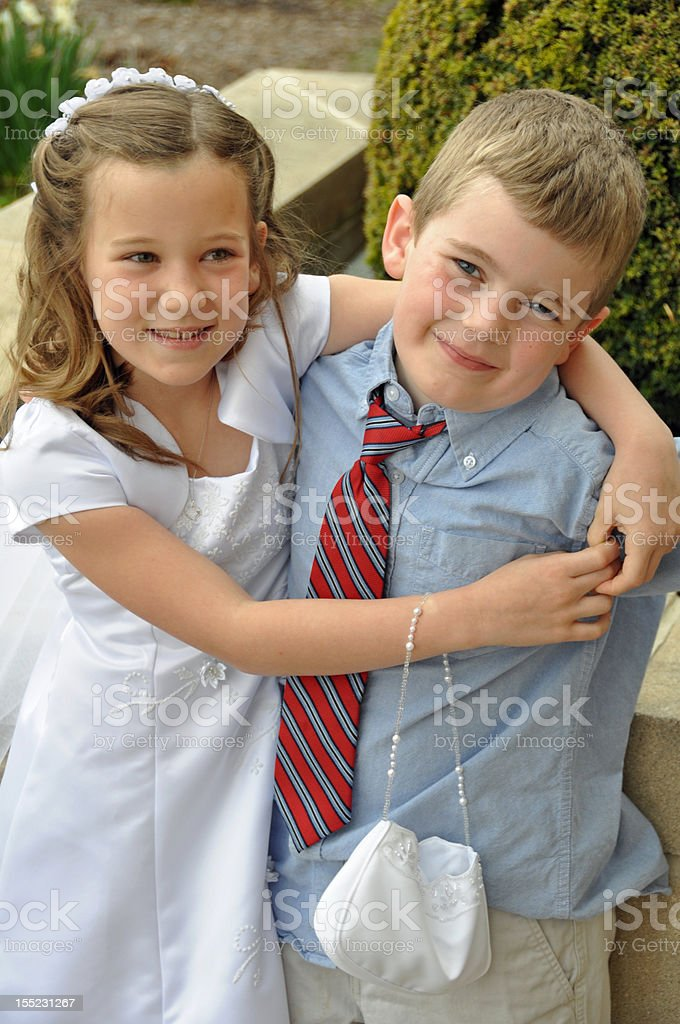 cute kids on first communion day royalty-free stock photo