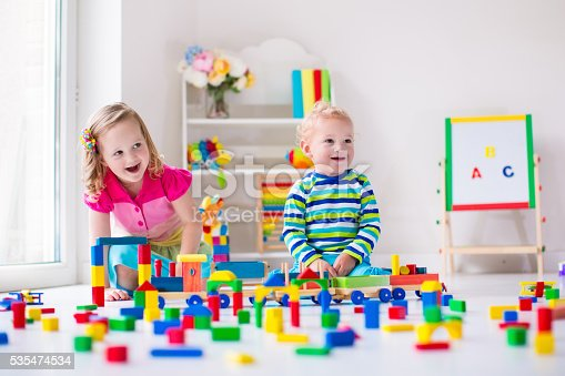 istock Cute kids playing at day care 535474534