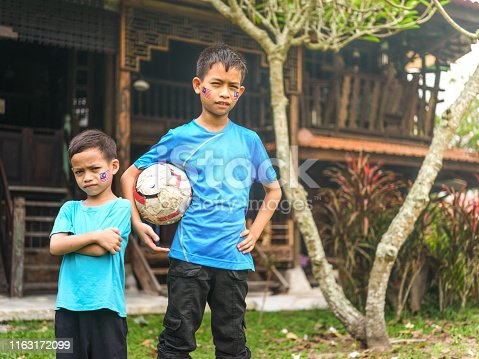 Cute kids standing with ball