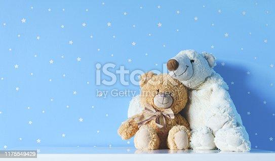 cute kids toys on the nightstand in blue nursery