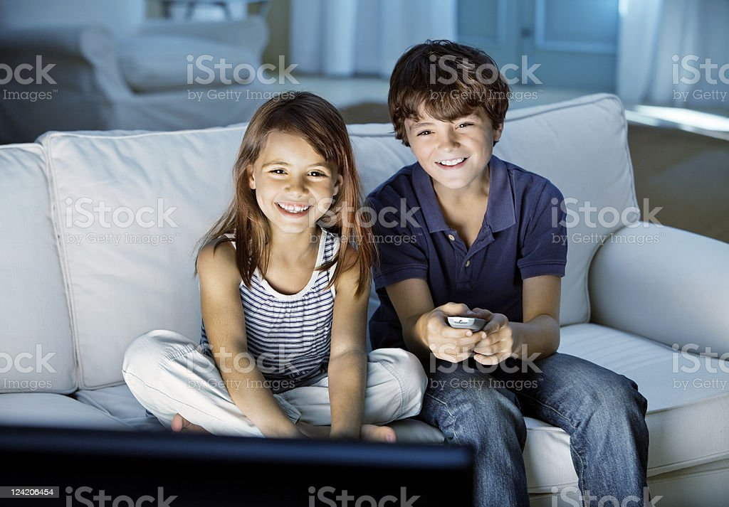 Cute kids watching television royalty-free stock photo