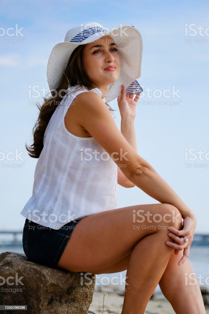Cute lady in a hat stock photo