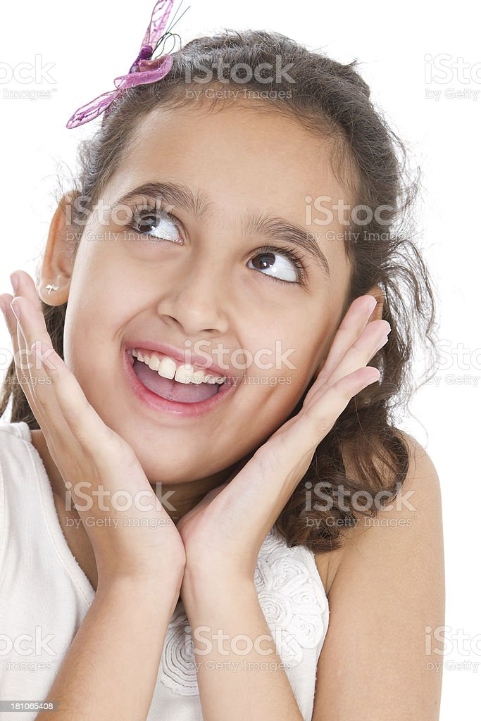 Cute latin american girl looking up royalty-free stock photo