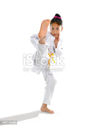 istock cute latin little girl in karate kimono training kick attack 495749489