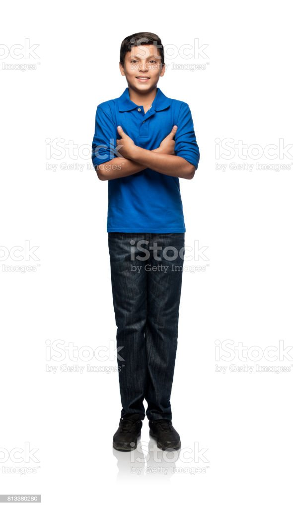 Cute latin teenage boy standing and looking at camera stock photo