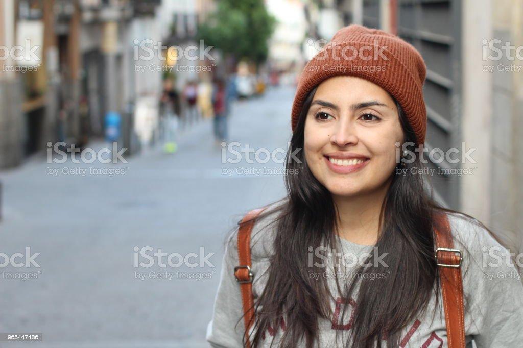 Cute Latin woman smiling on the street zbiór zdjęć royalty-free