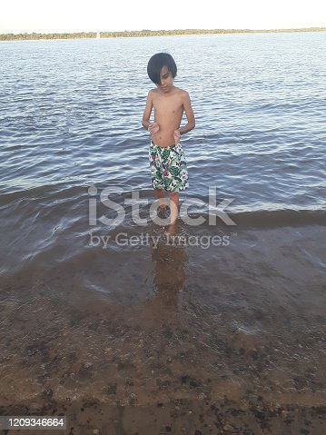 This young boy in Argentina is beachside near Buenos Aires, enjoying a refreshing summer day.