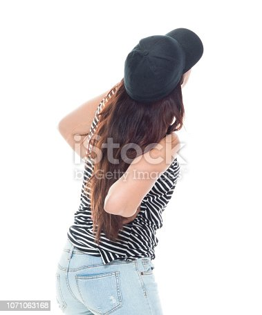 istock Cute latino female is feeling pain in her back 1071063168