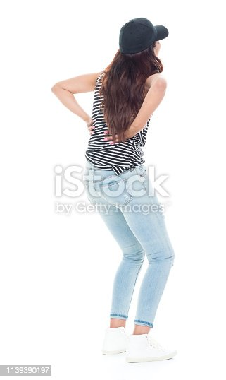 istock Cute latino female is feeling pain in her back 1139390197