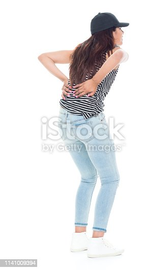 istock Cute latino female is feeling pain in her back 1141009394
