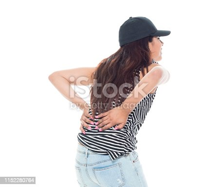 istock Cute latino female is feeling pain in her back 1152280764
