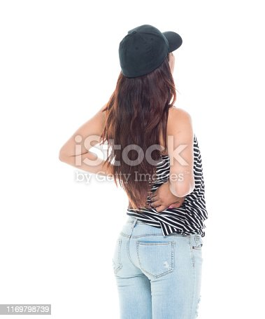 istock Cute latino female is feeling pain in her back 1169798739
