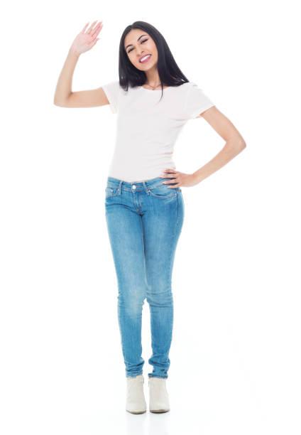 Süße Latino weiblich mit langen Haaren und tragen Jeans - winken – Foto