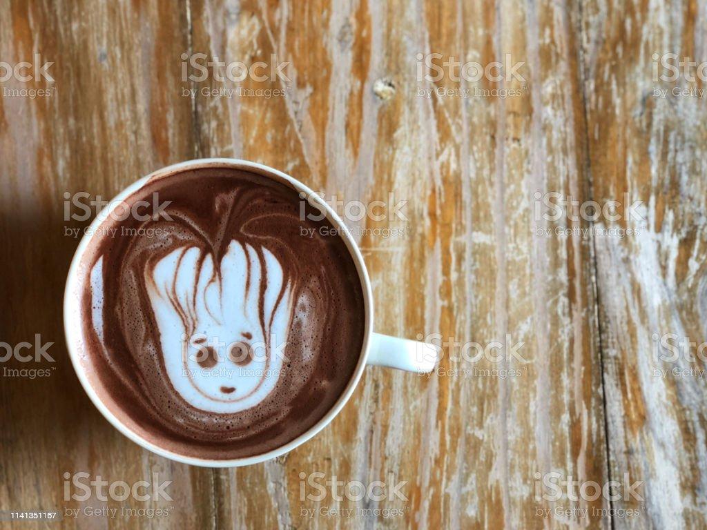 cute Latte art coffee on the wooden table, latte art coffee shape...
