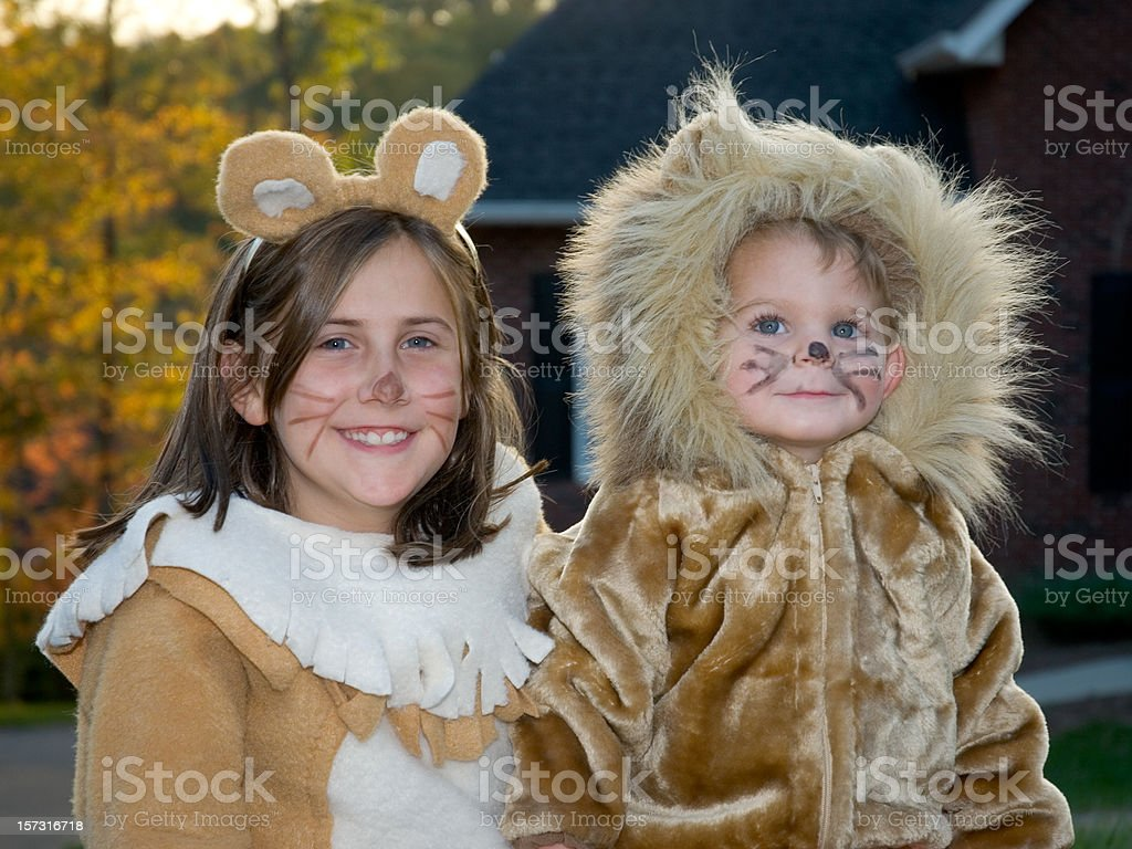 Cute Lion Halloween Costumes, Boy & Girl Trick Or Treating stock photo