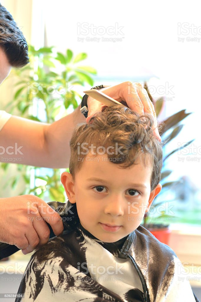 Cute Litlle Boy at Hairdresser´s. stock photo