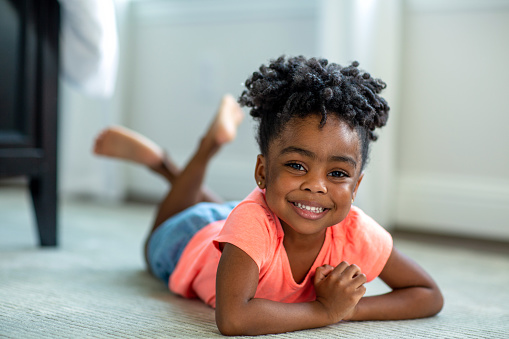 African American girl smiling and laughing at home.