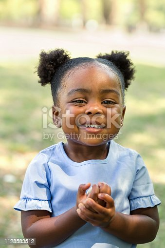 Happy African American little girl smiling.