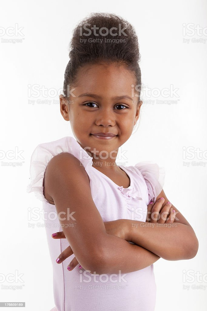 Cute little African Asian girl with folded arms royalty-free stock photo