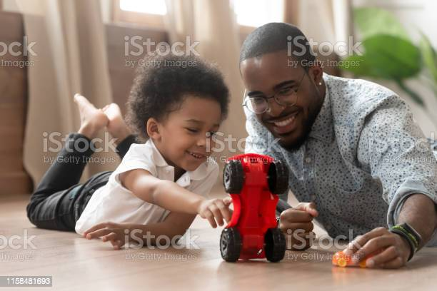 Cute little african kid son playing toy cars with dad picture id1158481693?b=1&k=6&m=1158481693&s=612x612&h=87jf igbckhstmckmjcsqrm4j83l2apogy8nqh5vyb8=