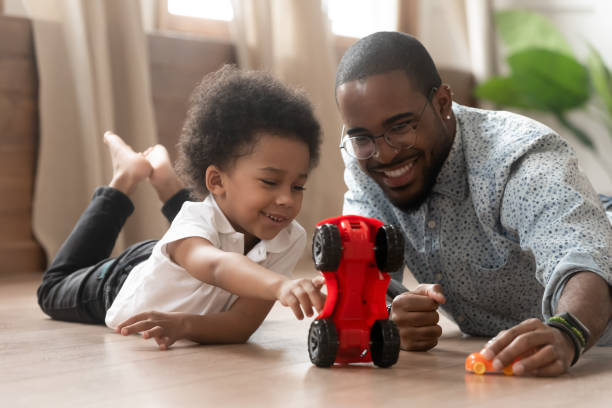 Cute little african kid son playing toy cars with dad picture id1158481693?b=1&k=6&m=1158481693&s=612x612&w=0&h=o1fg7lzw5vuagqgx4qfsnwgknhqucmclker9i3bmm08=