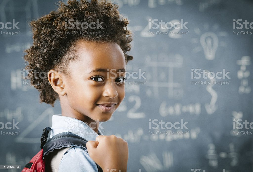 Cute little African school girl in classroom stock photo