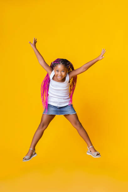 Cute little afro girl jumping over yellow studio background picture id1191645373?b=1&k=6&m=1191645373&s=612x612&w=0&h=znkv8fb4hozrclzg4dtwkbr9 xhmzugazd yeum40dg=