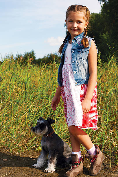 cute  little american girl with a her dog for a walk stock photo