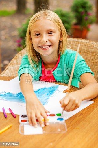637797672istockphoto Cute little artist. 518297647
