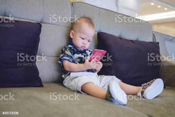 Cute little asian 18 months 1 year old baby boy child sitting on sofa picture id843123208?b=1&k=6&m=843123208&s=612x612&h= zc2nmfmgmrmom x6du1mpowtjrrk21layh4vbemtai=