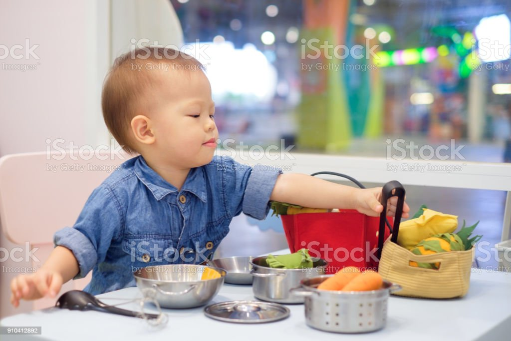 Cute little asian 18 months 1 year old toddler baby boy child having cute little asian 18 months 1 year old toddler baby boy child having fun playing forumfinder Choice Image