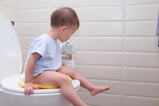 Child Sitting On Toilet Stock Photo 123005692 - Shutterstock