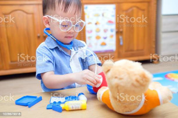 Cute little asian 2 years old toddler baby boy child concentrate on picture id1028679318?b=1&k=6&m=1028679318&s=612x612&h=9ijdq8jammf7vecxtuhtpdzxhuthddn xiqxhkbkvvm=