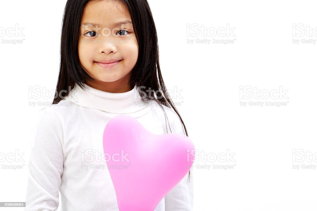 Cute Little Asian Girl Holding Pink Balloon Heart With Isolated On White Background Royalty Free