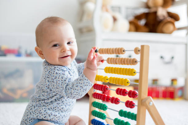 Cute little baby boy playing with abacus at home picture id931207768?b=1&k=6&m=931207768&s=612x612&w=0&h=knsatfaqauubkwua qdkqtyfvpjlxbgh18ao3snjo2s=