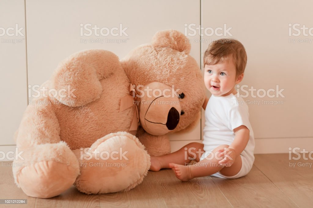 Cute Little Baby Boy With Big Teddy Bear Stock Photo More Pictures