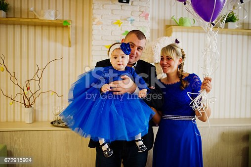930632bdf Cute Little Baby Girl At Blue Dress On Hands Of Father And Mother 1 ...
