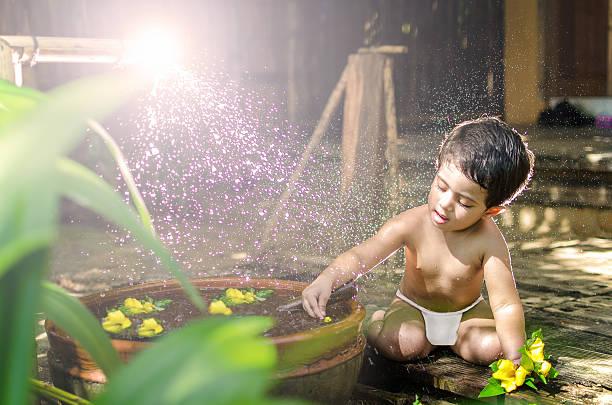 Cute little baby girl bathing & playing stock photo