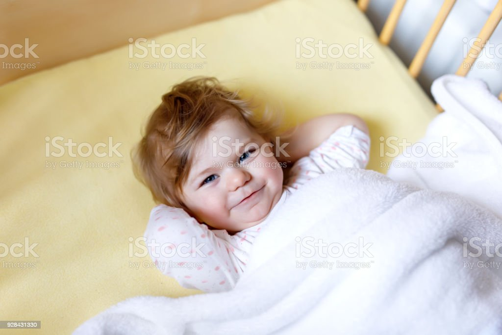 Cute Little Baby Girl Lying In Cot Before Sleeping Happy Calm Child