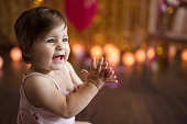 Cute little baby girl smiling and clapping