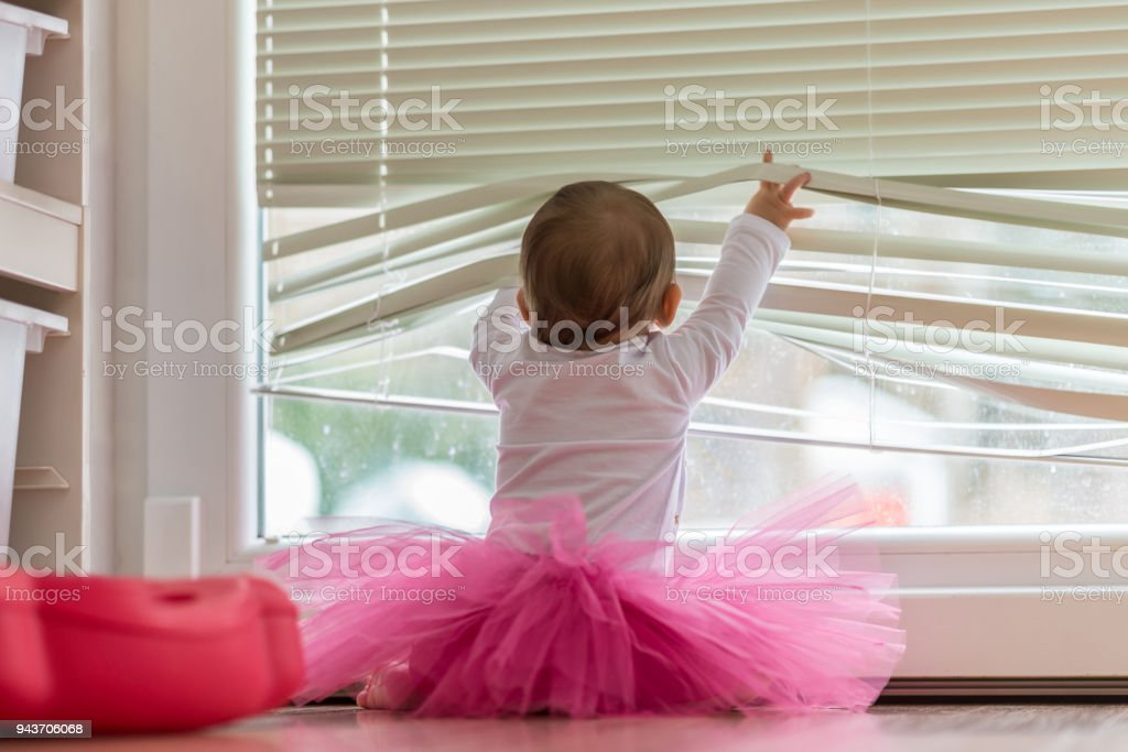 Cute little baby girl wearing a pink tutu stock photo