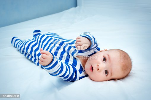 istock Cute little baby in bed 874856828