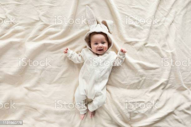 Cute little baby in bunny costume on blanket at home top view picture id1131560778?b=1&k=6&m=1131560778&s=612x612&h=r8flkseztm6gmgwhsuity7aqily90snhruihehpnlhi=