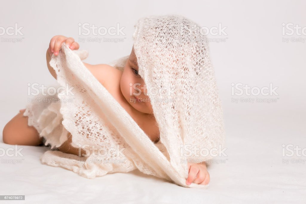 cute little baby lying at the white bed foto de stock royalty-free