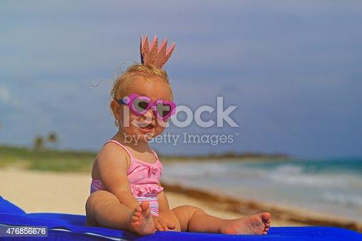 istock cute little baby princess on summer beach 476856676