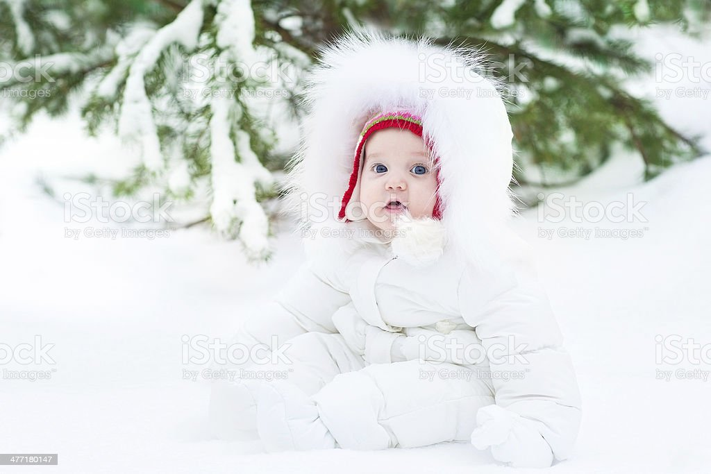 24953a6b431e Cute Little Baby Wearing Warm Winter Jacket And Red Hat Stock Photo ...