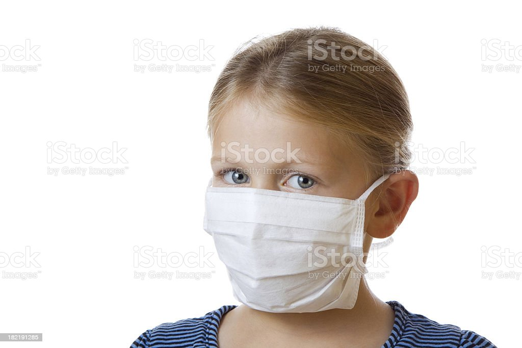 Cute little blond girl in face mask for flu protection royalty-free stock photo
