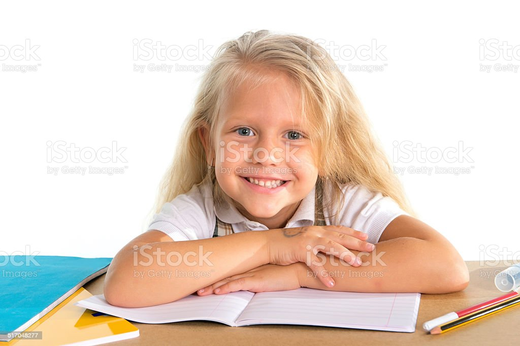 Cute Little Blonde Schoolgirl Smiling Happy On Desk Royalty Free Stock Photo