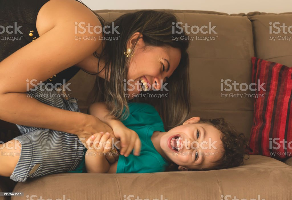 Cute little boy and his mother stock photo