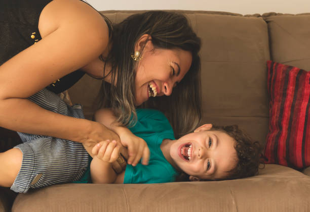 cute little boy and his mother - mother stock photos and pictures